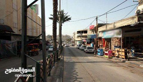أرض في مكان ممتاز (تقع على شارع عمر المختار مقابل
